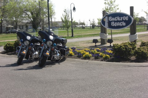 Police Motorcycles Parked Next to Buckroe Beach Sign