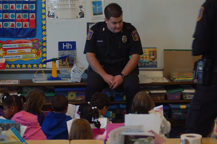 Officer in Classroom with Children Seated