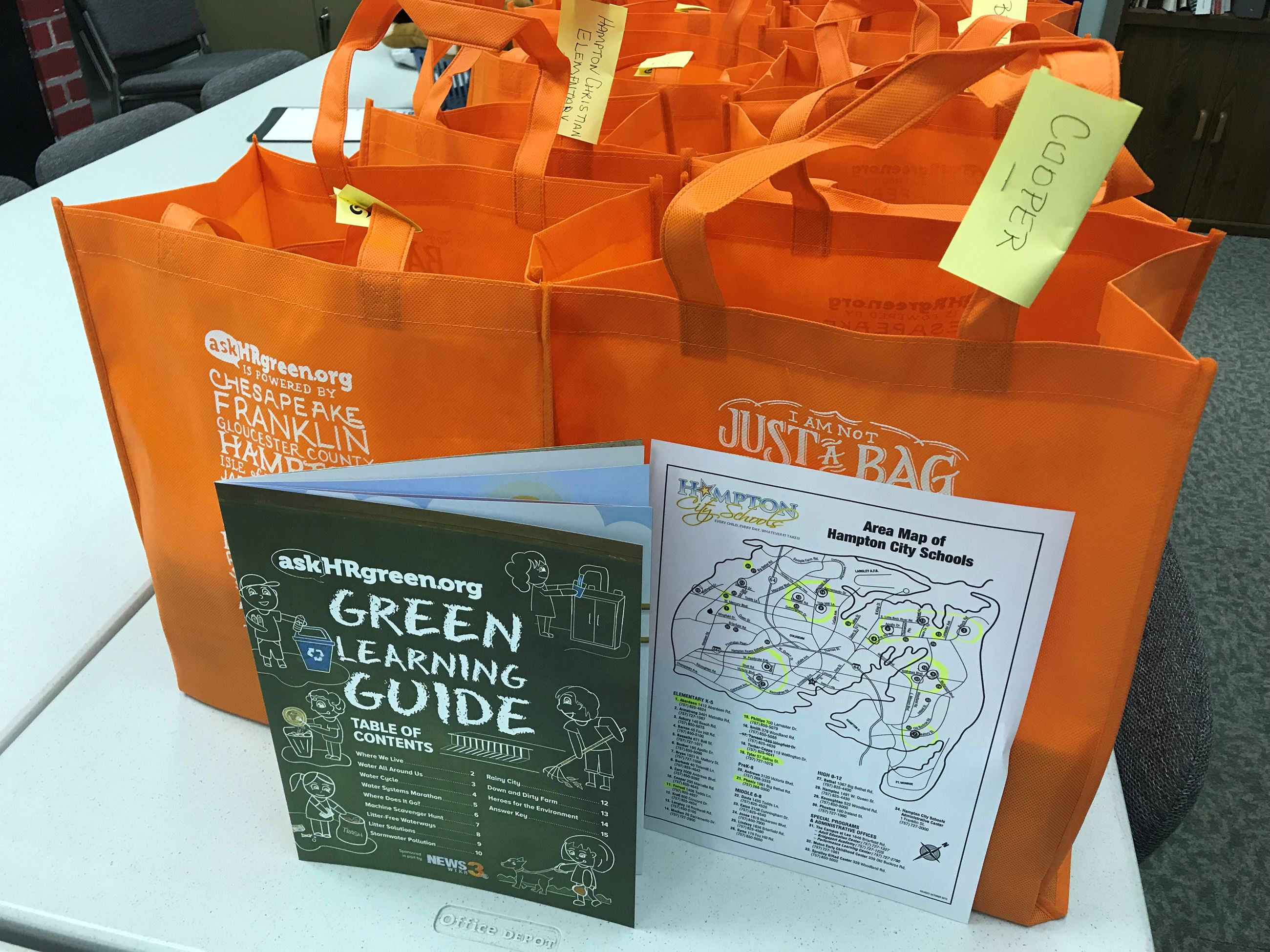 IMG_8516 Green Learning Guides packaged in reusable shopping bags